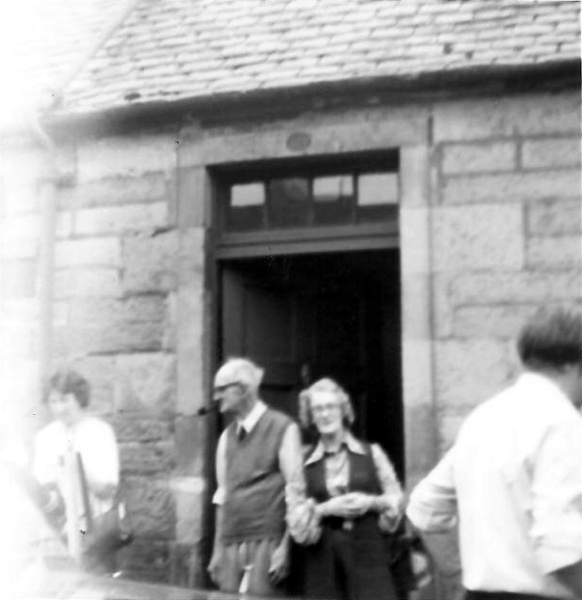 Grandad and Auntie Barbara in front of Ness Cottage